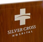 Cut Parts in Metal - Silver Cross Hospital Logo