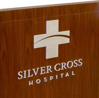 Cut Parts in Metal - Silver Cross Hospital Logo